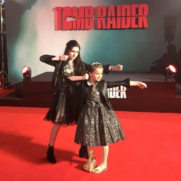 EMILY CAREY & MAISY DE FREITAS The Tomb Raider Movie Red Carpet Premiere