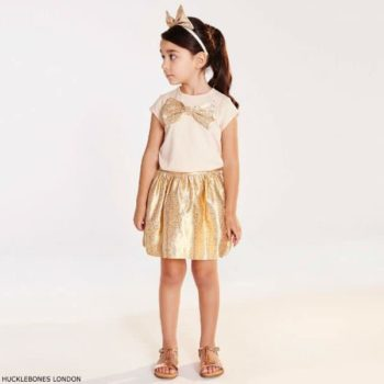 HUCKLEBONES LONDON Girls Pink Top with Gold Bow & Gold Jacquard Skirt