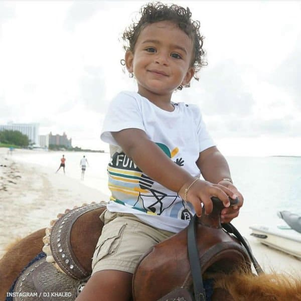 asahd khaled fendi tshirt horseback riding on beach
